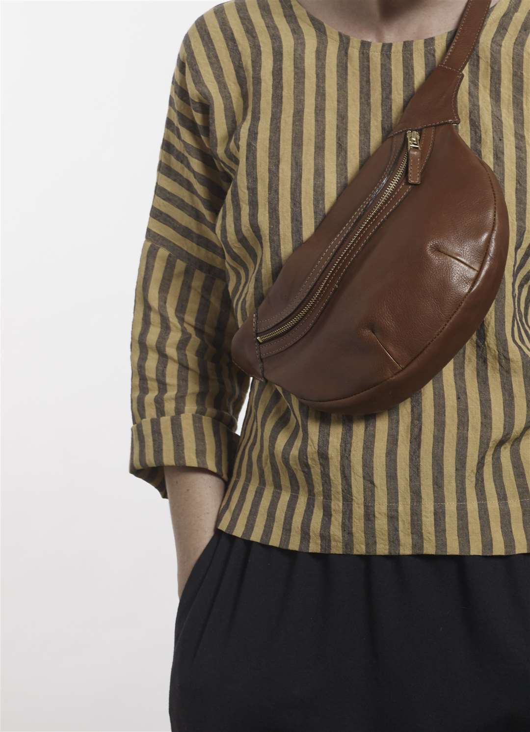 M.Hulot Lowe Bumbag in Conker, £175, and Parkers Striped Batwing top, £140, mhulot.co.uk (32921608)